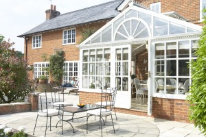 Exterior Of House With Conservatory And Patio